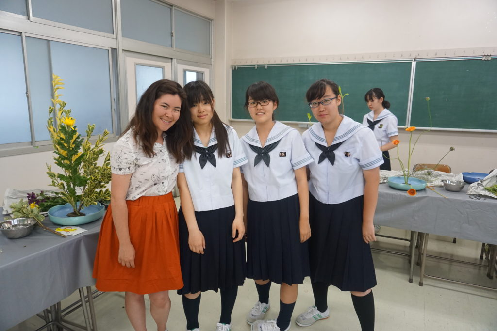 Megan with three students inside a classroom